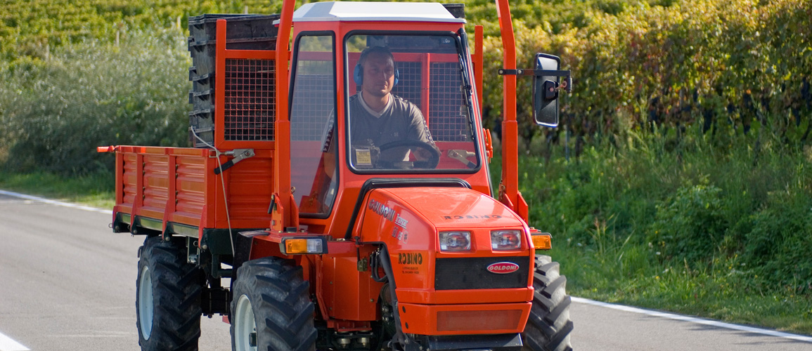 Red tractor of wine producer
